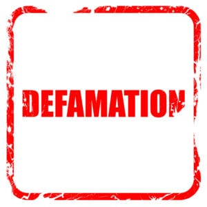 57088399 - defamation, red rubber stamp with grunge edges